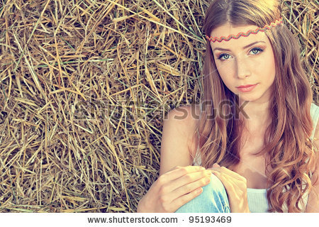 stock-photo-romantic-young-woman-posing-outdoor-95193469