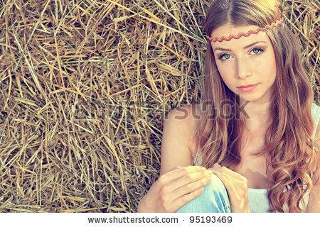 stock-photo-romantic-young-woman-posing-outdoor-95193469