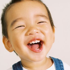 toddler-laughing-showing-teeth-photo-420x420-ts-78160810