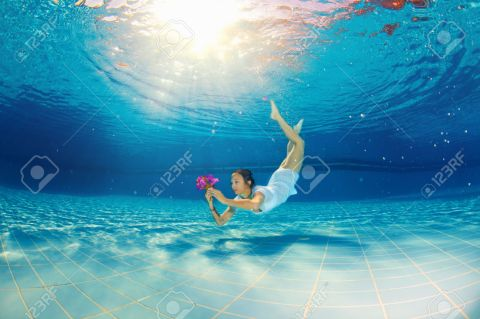 24138933-girl-diving-under-the-water-with-flowers-Stock-Photo-underwater