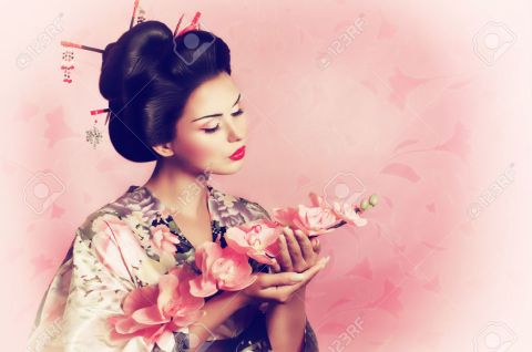 22612896-Portrait-of-a-Japanese-geisha-woman-Stock-Photo